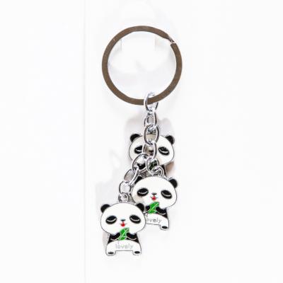 Металлический брелок три панды с листиком